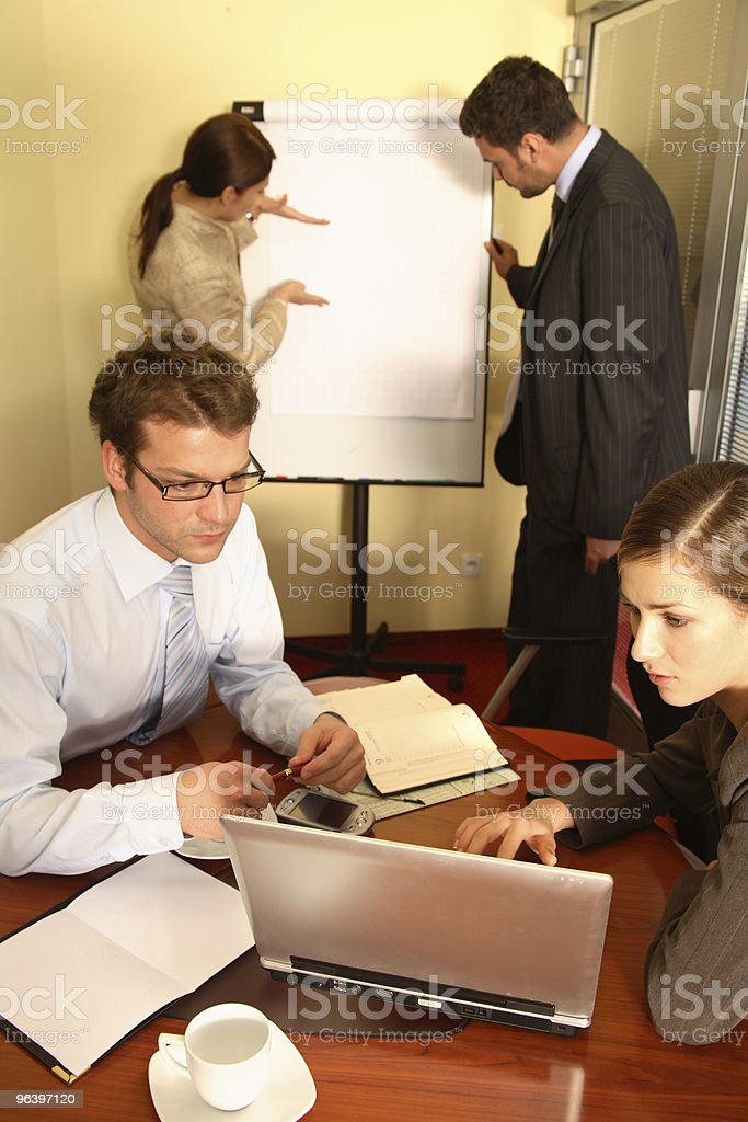 Business Team Preparing a Proposal - Royalty-free Adult Stock Photo