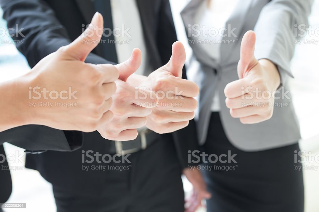 business team show thumb up stock photo