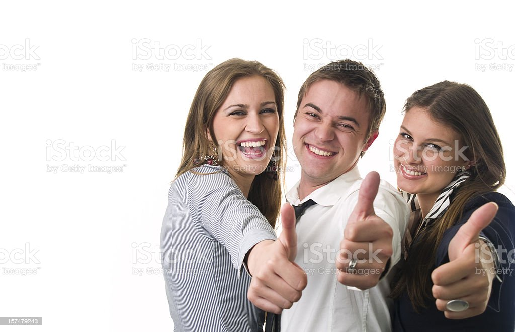 Business team showing thumb's up sign. stock photo