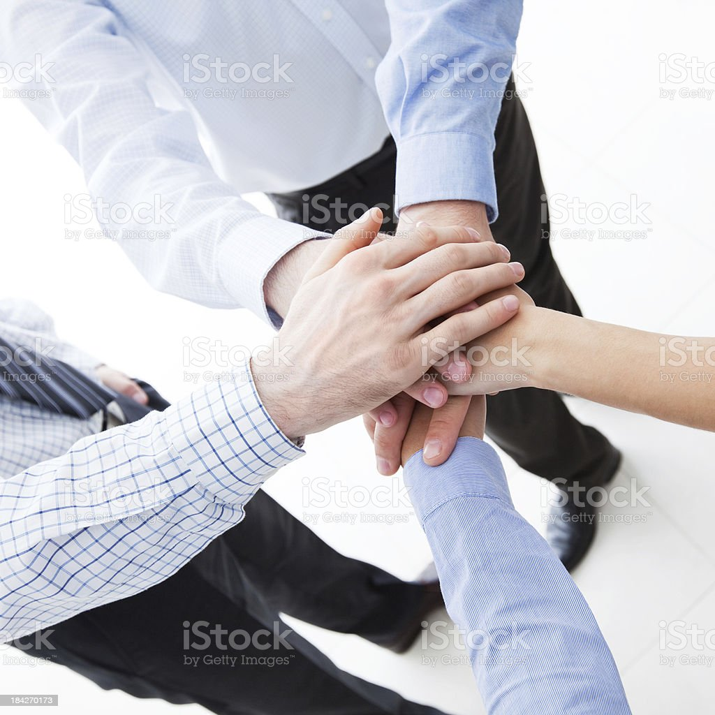 Business team showing unity Business people wearing formalwear joining hands. Elevated view. Adult Stock Photo
