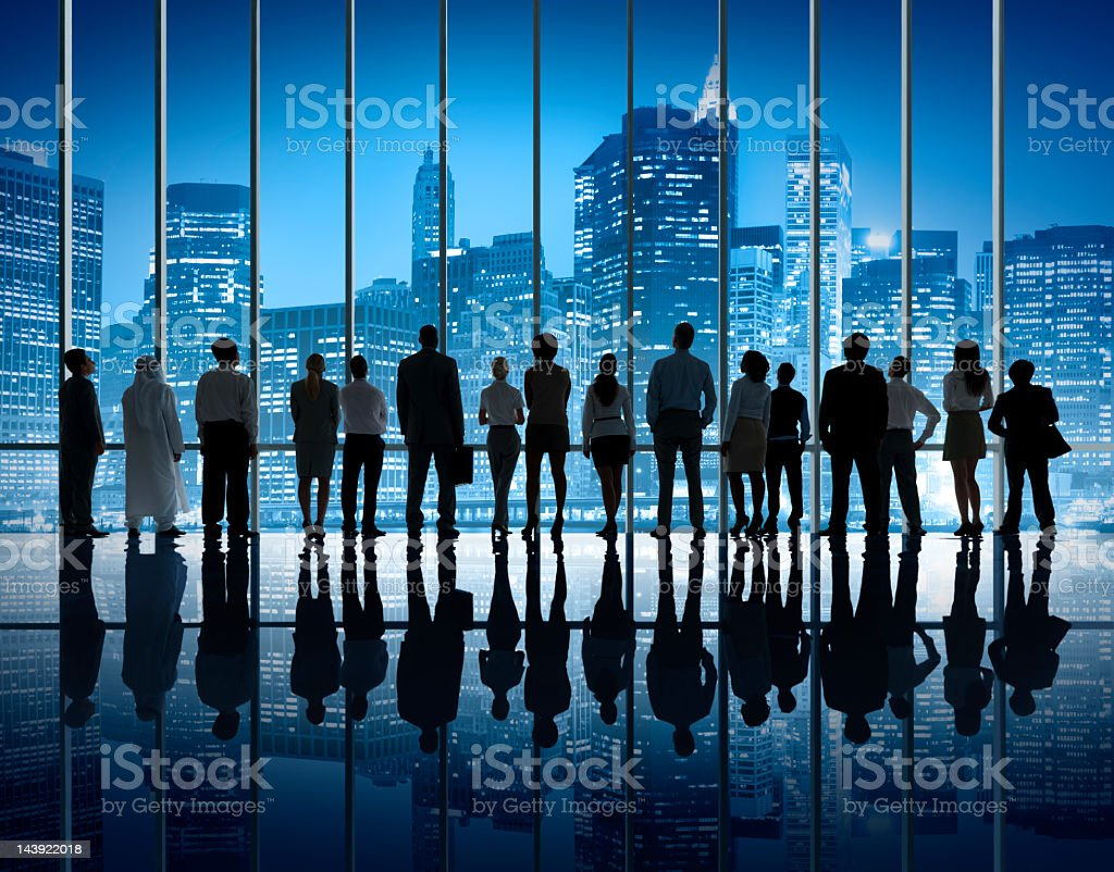Business Team Silhouette Staring at New York Night Skyline. royalty-free stock photo