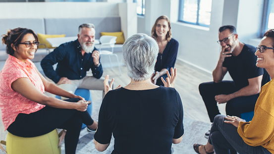 istock Business team sitting in circle and discussing 1145976069