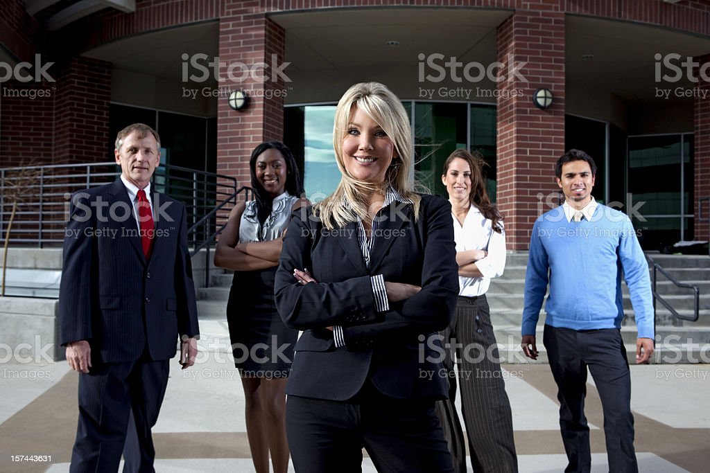 Business team standing outide looking at camera stock photo