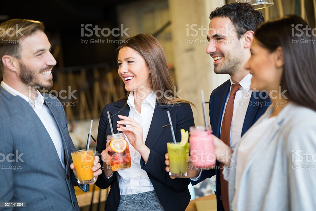 Business team taking a break and drinking healthy smoothies stock photo