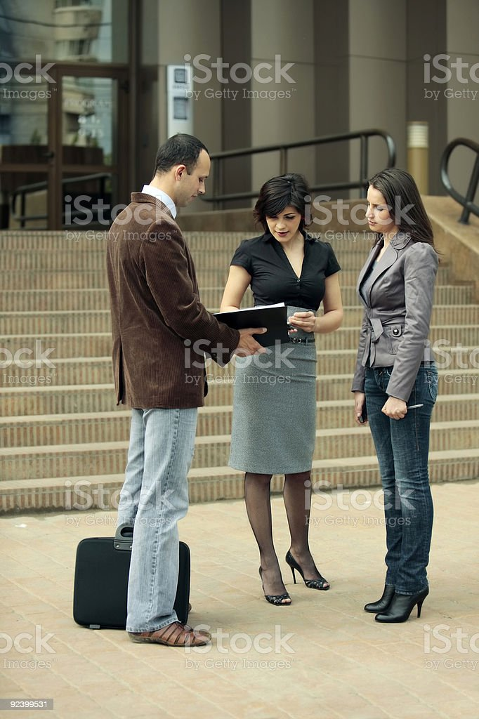 Business team talking at staff meeting outdoors royalty-free stock photo
