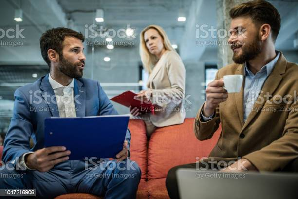 Business team talking during a casual meeting in the office picture id1047216906?b=1&k=6&m=1047216906&s=612x612&h=f6nvdtd9zmdeqbhw p d8nvozkqncj abrwr  ztay0=