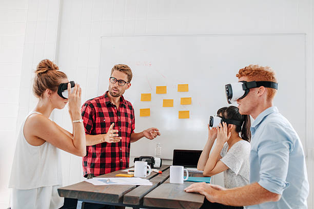 Business team testing virtual reality headset in meeting stock photo