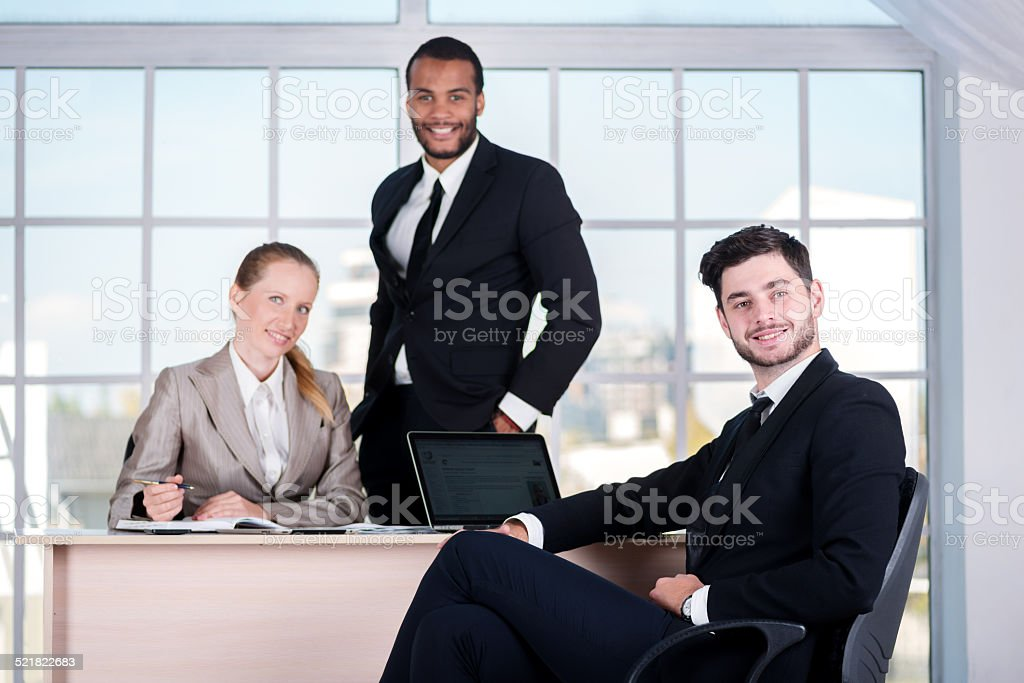 Business team. Three businessman sitting at the table while thre stock photo