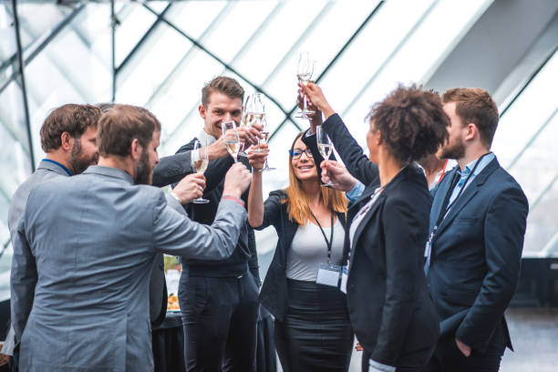 Business team toasting during a break stock photo