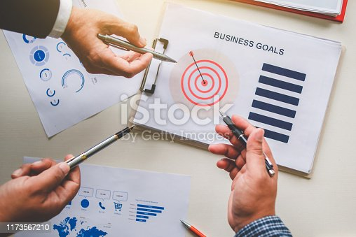 875531516istockphoto Business team together pointing to business goals, business goal concept 1173567210