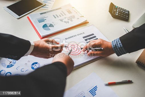 875531516istockphoto Business team together pointing to business goals, business goal concept 1173582814