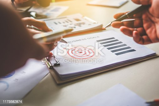 875531516istockphoto Business team together pointing to business goals, business goal concept 1173582874