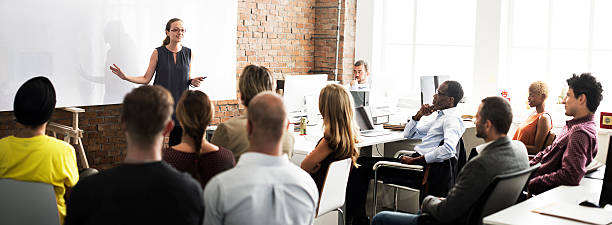 business team training listening meeting concept - train stock photos and pictures