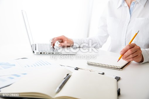 istock Business team two colleagues discussing new plan financial graph data 970128930