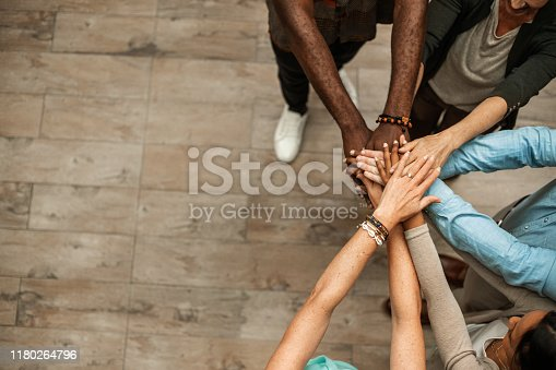 Business people join hands and showing their unity