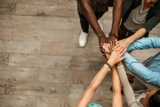 Business Team Unity Business people join hands and showing their unity unity stock pictures, royalty-free photos & images