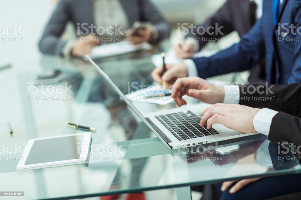 business team using a laptop is doing a marketing report on workplace foto stock royalty-free