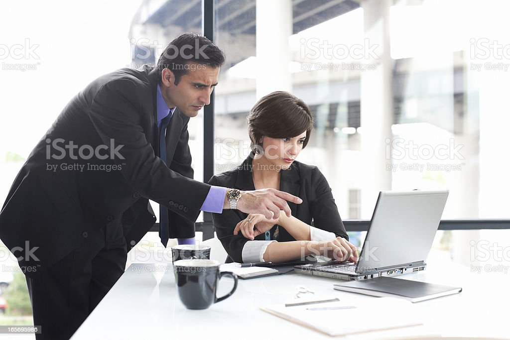 Business Team Using Laptop in Glass Office, Copy Space royalty-free stock photo