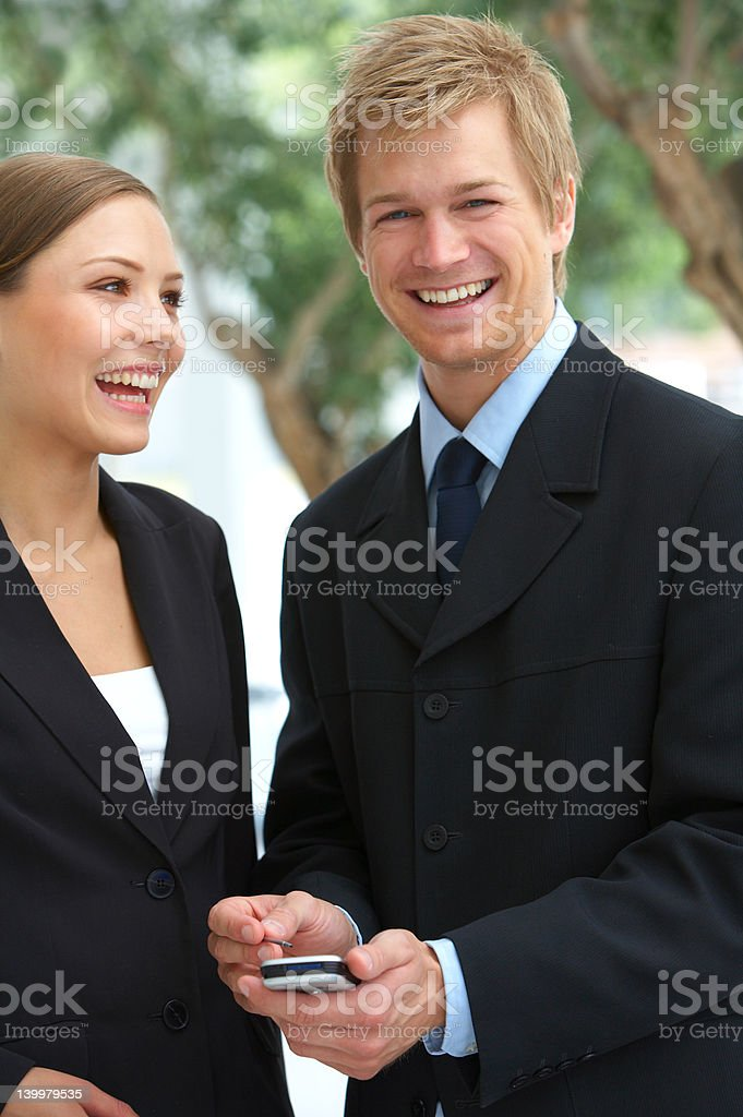 Business team using pda mobile phone royalty-free stock photo