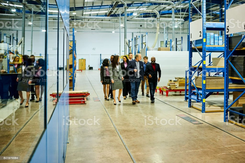 Business team visiting  in factory stock photo
