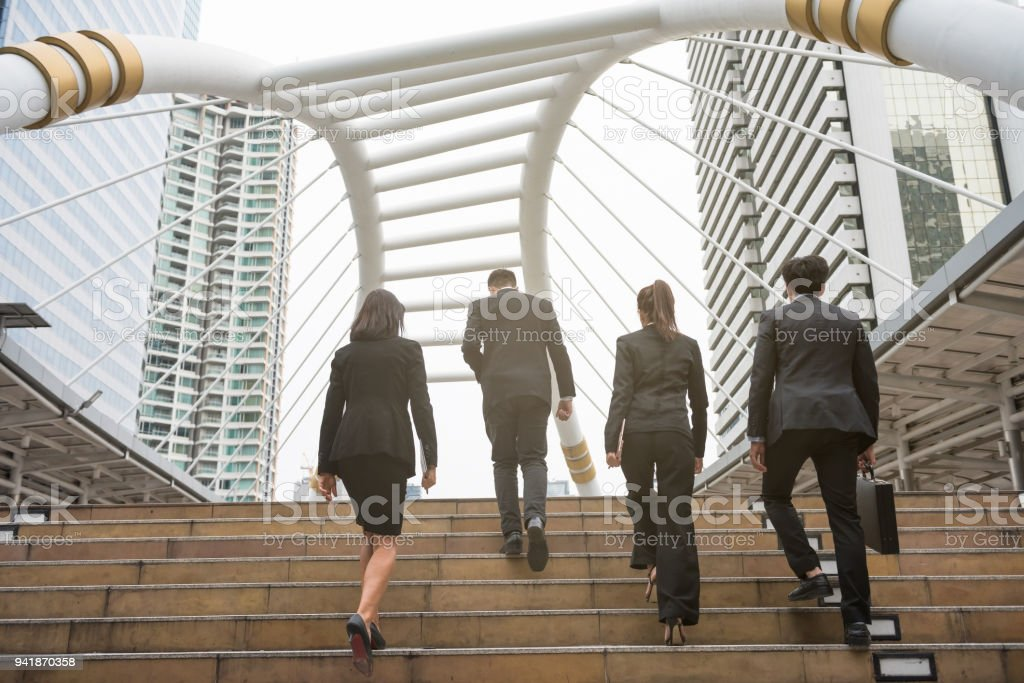 Business team walking in city stock photo