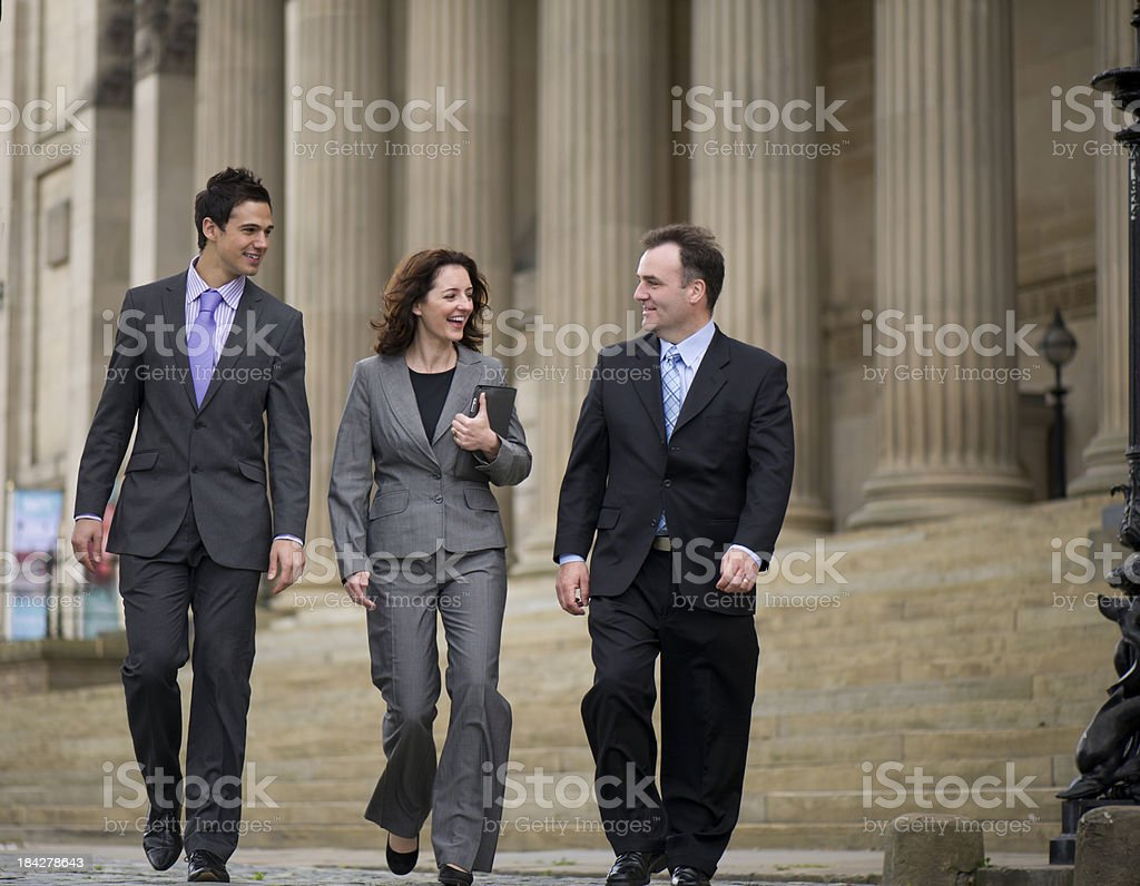 business team walking stock photo