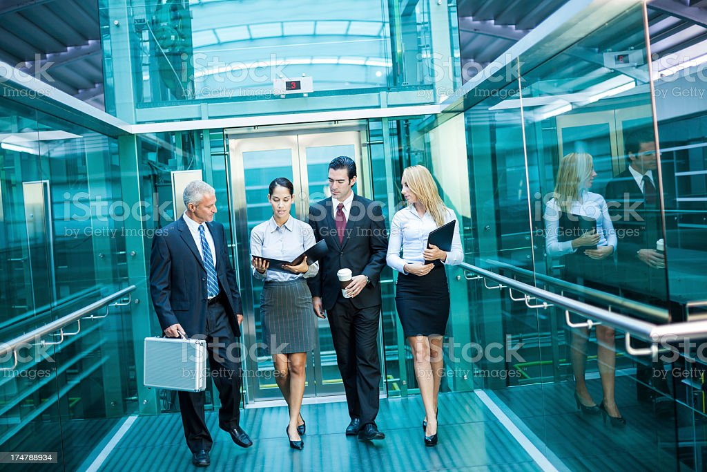 Business team walking together stock photo