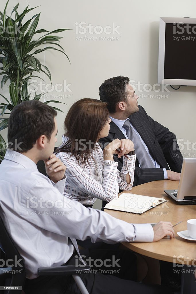Business Team watching tv - Royalty-free Adult Stock Photo
