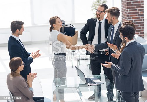 istock business team welcomes the new employee to the workplace 1020248468