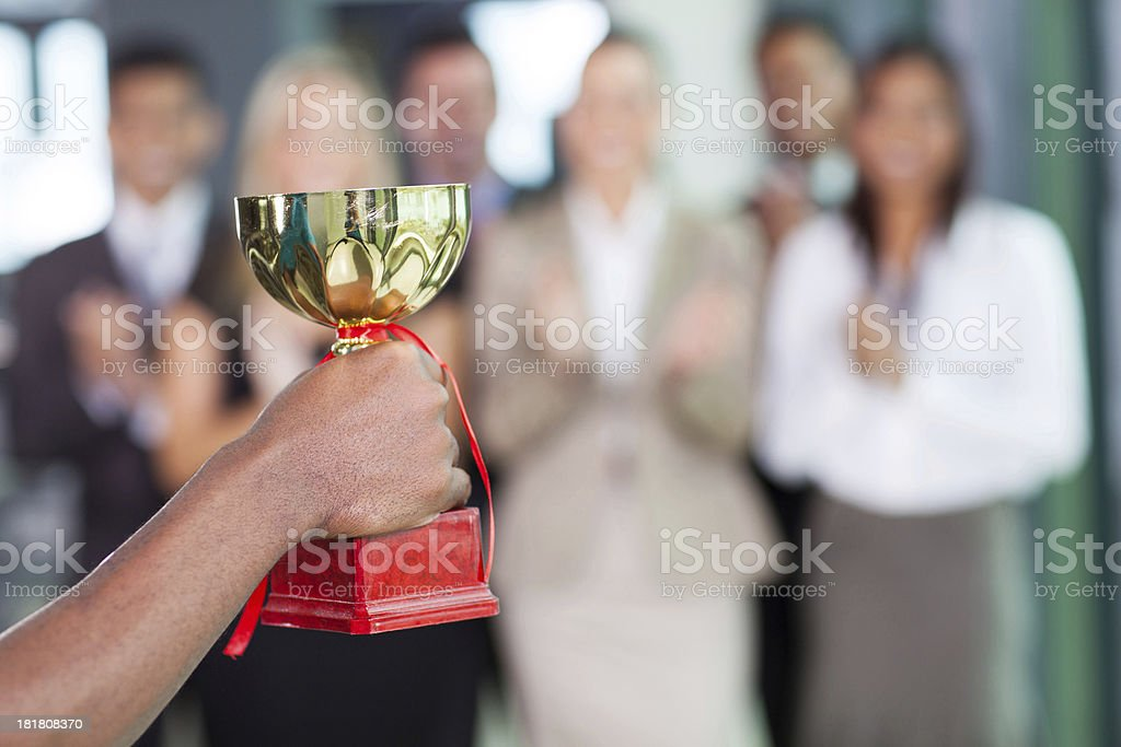 business team winning a trophy stock photo