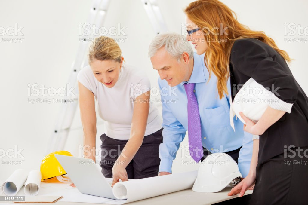 Business Team With Blueprint. royalty-free stock photo