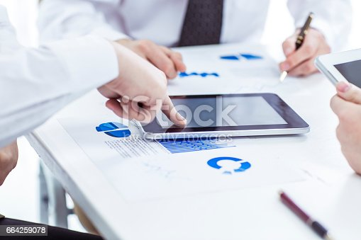 istock business team with digital tablet and smartphone working with financial charts 664259078