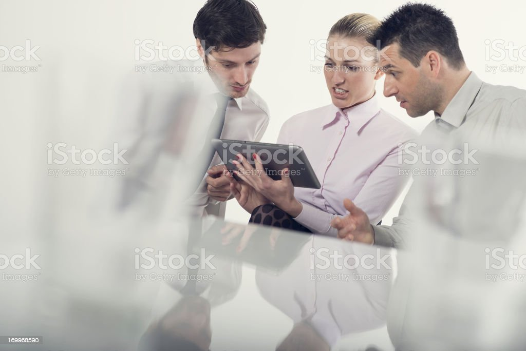 Business team with digital tablet having disscussion royalty-free stock photo