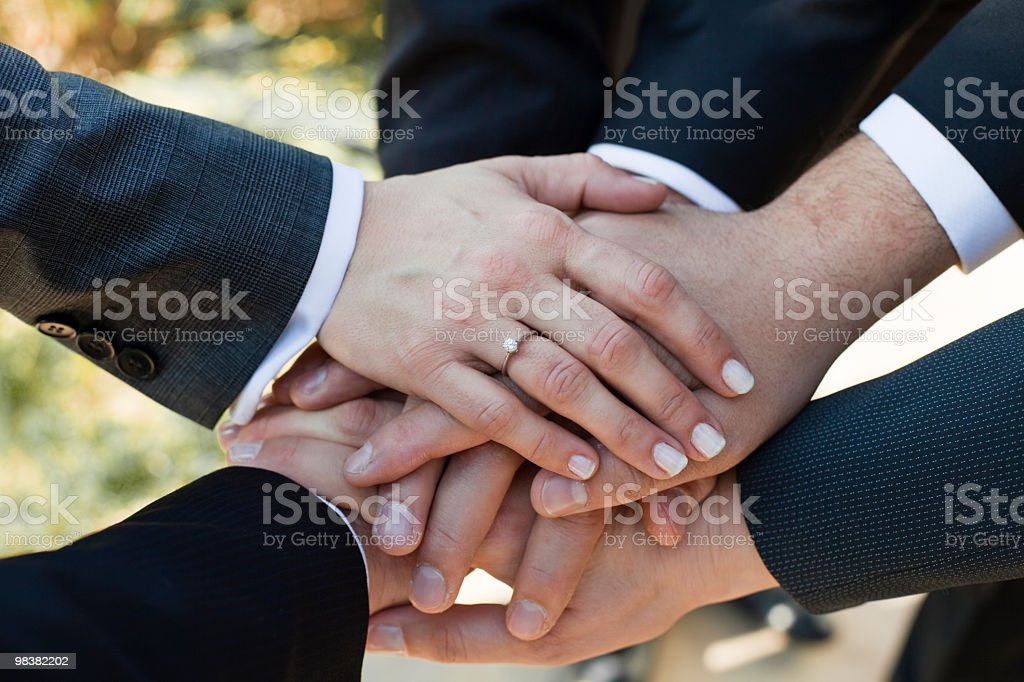 Business team with their hands stacked together royalty-free stock photo