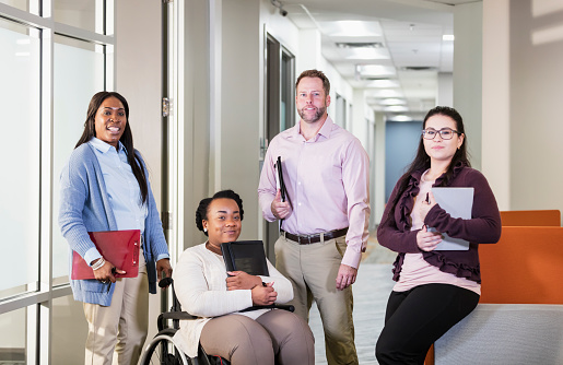 660681964 istock photo Business team, woman in wheelchair 1145865516