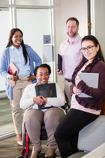660681964 istock photo Business team, woman in wheelchair 1171432335