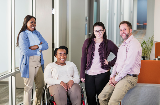 660681964 istock photo Business team, woman in wheelchair 1198648088