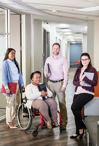 660681964 istock photo Business team, woman in wheelchair 1198648705
