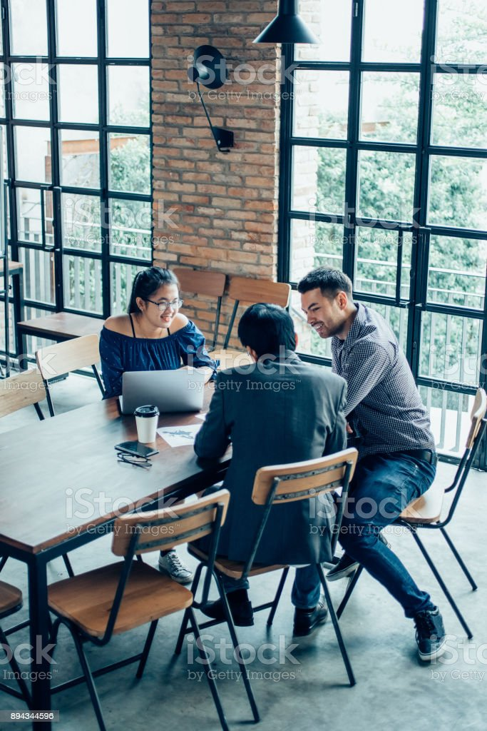 Business Team Working at Cafe Table stock photo