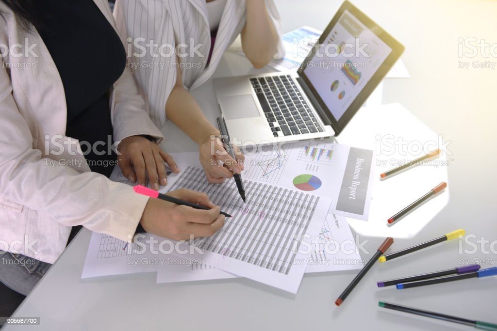 Business team working computer laptop data analysis and documentation...