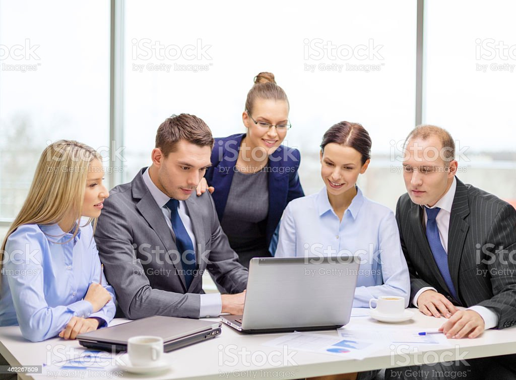 Business team working on a laptop stock photo