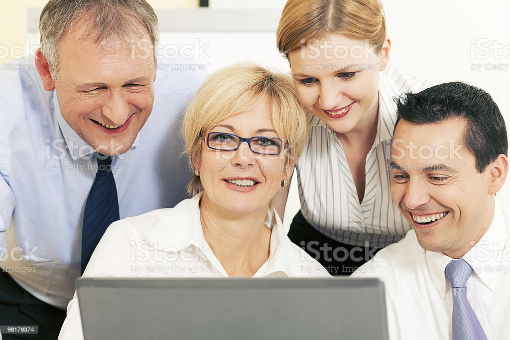 Business team working on computer royalty-free stock photo
