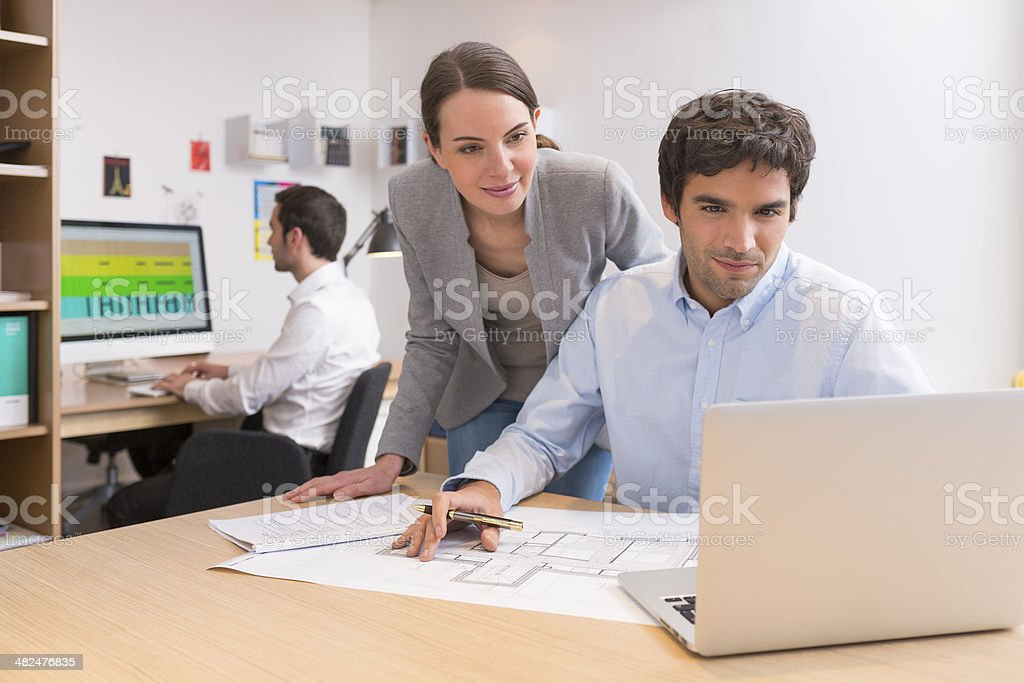 Business team working on laptop in office royalty-free stock photo