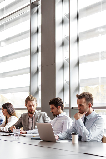 Business Team Working Together In An Office Stock Photo - Download Image Now