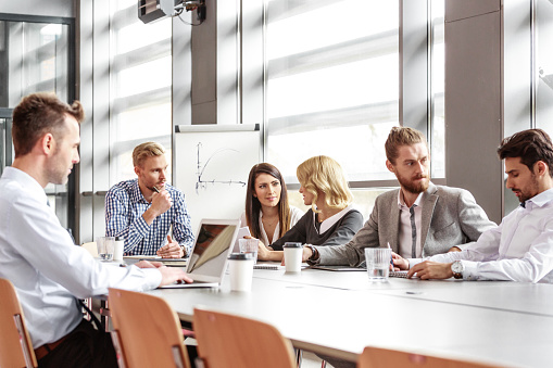 Business Team Working Together In Board Room Stock Photo - Download Image Now