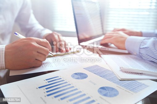 istock business team working with charts and financial data, teamwork 881635754