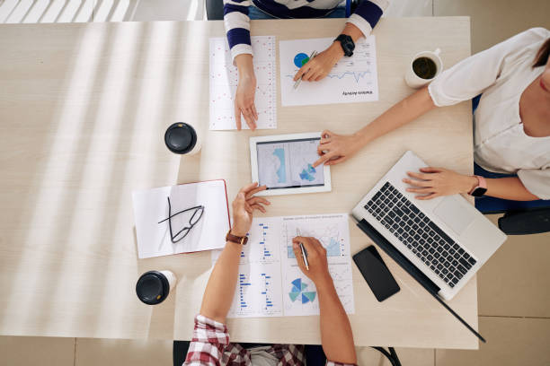 Business team working with reports stock photo
