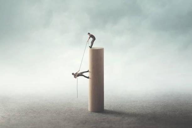 business teamwork concept; man help friend stock photo