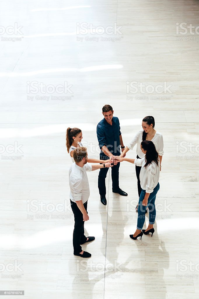 Business teamwork. People with joined hands. Union stock photo