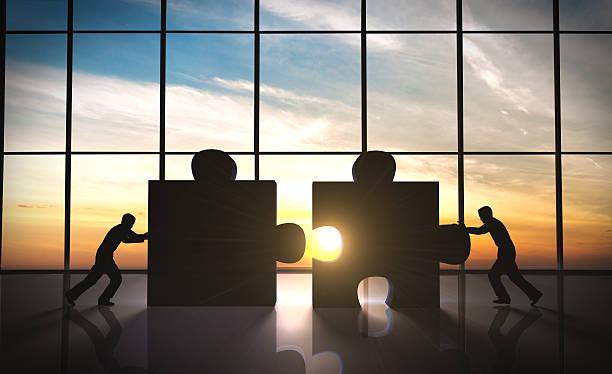 business teamwork-puzzle stücke - puzzleteile stock-fotos und bilder